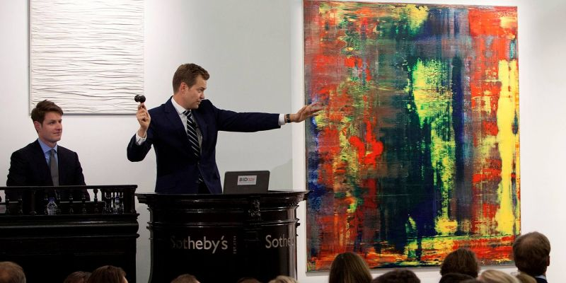 An Auctioneer Directing Bidding For The Sale Of Gerhard Richter's Abstraktes Bild (809 4), From The Collection Of Musician Eric Clapton